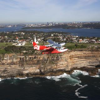 Seaplane flying above the Bondi Cliffs