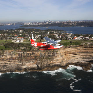 Seaplane flying above the Bondi Cliffs