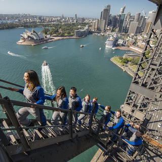 People walking up the steps of the Sydney Harbour Bridge