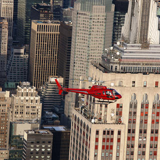 Helicopter by Empire State Building